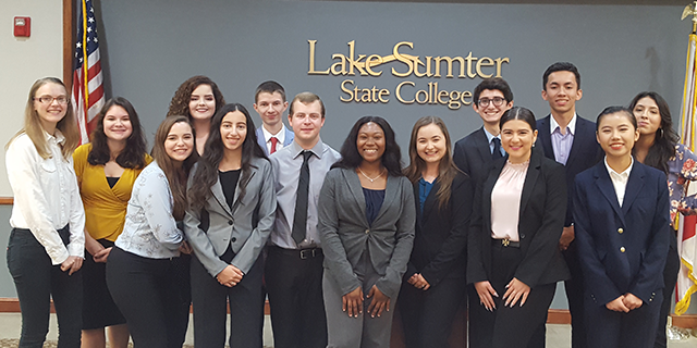 A group of Honors students in business attire at Lake-Sumter State College