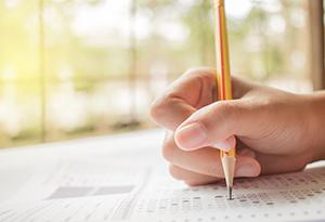 Pencil filling in test bubble on standardized test form
