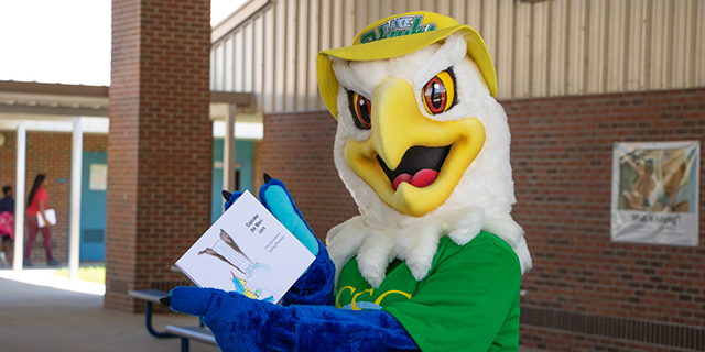 Swoop posing with the childrens book